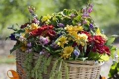 Beautiful summer floral arrangement in a wicker basket. Stock Photography