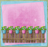 Beautiful summer flowers in pots on  fence Stock Photos