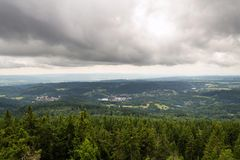 Beautiful summer forest view from Pajndl lookout tower, Krusne Hory. Beautiful summer forest view from Pajndl lookout tower cloudy sky copy space, Tisovsky Mount Stock Images