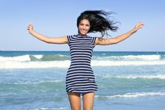 Beautiful summer girl jumping on the beach Royalty Free Stock Photography