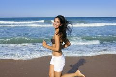 Beautiful summer girl jumping on the beach Stock Photo
