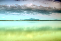 Beautiful summer landscape with cloudy sky, mountain and natural lake in Poland Royalty Free Stock Images