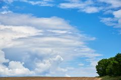 Beautiful summer landscape with cumulus clouds stock photos