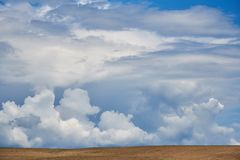Beautiful summer landscape with cumulus clouds in the sky royalty free stock image