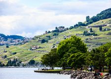 Beautiful Summer landscape of Lake Geneva, Lavaux vineyard terraces and Alps, Lutry village, Switzerland, Europe Stock Photo