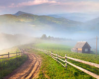 Beautiful summer landscape in mountain village. Beautiful summer landscape in a mountain village. Foggy morning stock image