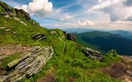 Beautiful summer landscape in mountains. View from the hillside in to the valley and nearby ridge under the cloudy sky Royalty Free Stock Photos
