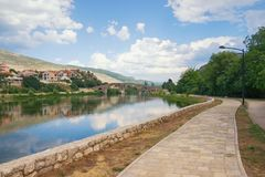Beautiful summer landscape with picturesque river and old stone bridge. Bosnia and Herzegovina, Trebinje, Arslanagic Bridge. Beautiful summer landscape with royalty free stock photo