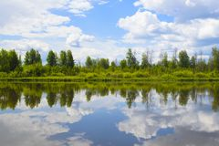 Beautiful summer landscape with reflection of clouds in the rive Royalty Free Stock Photography