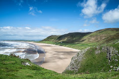 Beautiful Summer landscape of Rhosilli Bay beach Gower peninsula Royalty Free Stock Images