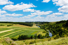 Beautiful summer landscape of river in the valley, fields and fo Royalty Free Stock Photo