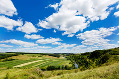 Beautiful summer landscape of river in the valley, fields and fo Royalty Free Stock Image
