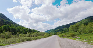 Beautiful summer landscape with a road running between the mount Royalty Free Stock Images