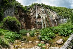 A beautiful summer landscape of waterfalls falling down from the mountains. Royalty Free Stock Photography