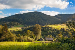 Beautiful summer landscape whith nice village house and mountain. S. Blue sky and clouds Royalty Free Stock Photography