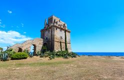 Torre Colimena on Salento sea coast, Italy. Picturesque historical fortification tower Torre Colimena on Salento Ionian sea coast, Taranto, Puglia, Italy Stock Photos