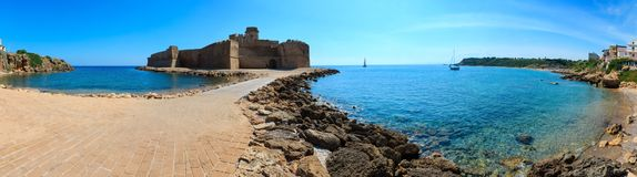 Aragonese castle of Le Castella, Calabria, Italy. Aragonese castle of Le Castella, a fortress on a small islet on Ionian Sea coast, overlooking the Costa dei Royalty Free Stock Photography
