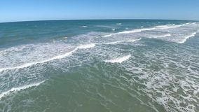 Beautiful summer morning at Cocoa surf beach Florida in white calm foam wave of Atlantic ocean skyline 4k drone seascape. Beautiful summer morning at Cocoa surf stock video footage
