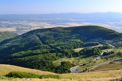 Beautiful Summer Mountain Landscape with Forested  Hills. Mountainous landscape with forested hills. Beautiful summer scenery in Bulgaria Stock Images