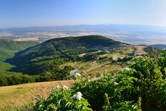 Beautiful Summer Mountain Landscape with Forested  Hills. Mountainous landscape with forested hills. Beautiful summer scenery in Bulgaria Royalty Free Stock Images