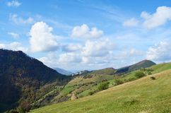 Beautiful Summer Mountain Landscape with Forested  Hills. Mountainous landscape with forested hills. Beautiful summer scenery in Rhodope Mountains , Bulgaria Royalty Free Stock Photo