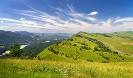 Beautiful Summer Mountains Landscape. Beautiful Summer Landscape: Mountains Covered by Trees, Green Hills and Blue Sky with White Clouds (Altai Stock Images