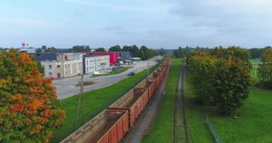 Oil and gas, transport by train. Beautiful summer nature and cargo train, runs through the city. Aerial footage stock footage