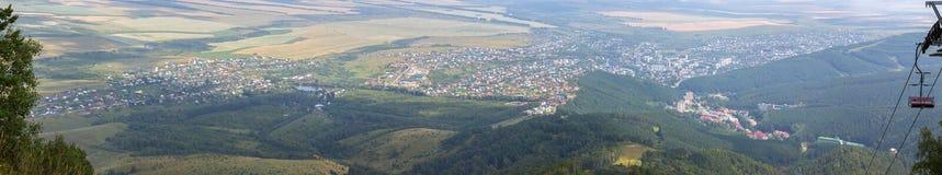 Beautiful summer panorama from Mount Tserkovka to resort of Belokurikha in the Altai Krai. Beautiful summer panorama from Mount Tserkovka to the resort of Stock Photo