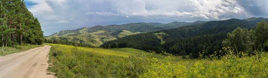 Beautiful summer panorama of the road in Altai Mountains. Beautiful summer panorama of the road in the Altai Mountains Stock Photo