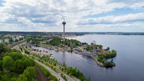 Beautiful summer panorama of Tampere city at summer day. Lakeside amusement park royalty free stock photo