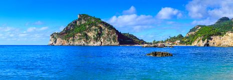 Beautiful summer panoramic seascape. View of the coastline into. The sea bays with crystal clear azure water. Paleokastrica. Corfu. Ionian archipelago. Greece royalty free stock photography