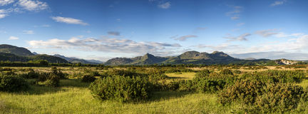 Beautiful Summer panoramic view from Porthmadog Cob towards Snow Royalty Free Stock Photo