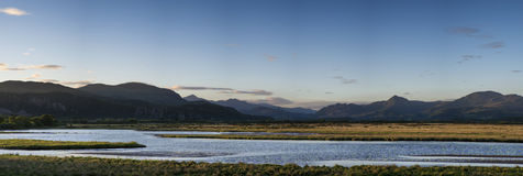 Beautiful Summer panoramic view from Porthmadog Cob towards Snow Stock Images