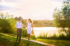 Beautiful summer picture on the nature by the river. A loving couple at a gazebo. Stock Photography