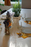 Beautiful summer room interior with table set for dinner Royalty Free Stock Images