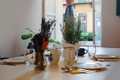 Beautiful summer room interior with table set for dinner Royalty Free Stock Photo