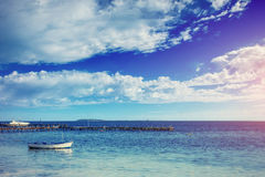 Beautiful summer scene of calm seas and boat Royalty Free Stock Photography