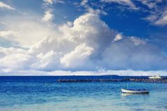 Beautiful summer scene of calm seas and boat Royalty Free Stock Photo
