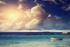 Beautiful summer scene of calm seas and boat Royalty Free Stock Images