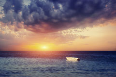 Beautiful summer scene of calm seas and boat. Stock Images