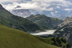 Beautiful summer scenery of the Dolomites and Lago di Fedaia. It Royalty Free Stock Photography