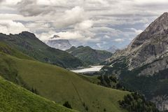 Beautiful summer scenery of the Dolomites and Lago di Fedaia. It Royalty Free Stock Photos