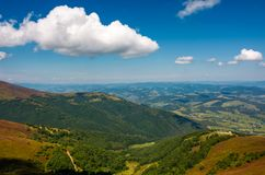 Beautiful summer scenery in mountains. View down in to the valley from the top of a mountain Royalty Free Stock Photos