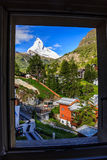 Beautiful summer scenic view on snowy iconic Matterhorn peak (Monte Cervin, Mont Cervino) in sunny day blue sky. Looking down the village, with blur royalty free stock photos