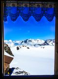 Beautiful summer scenic view on snowy Swiss Alps in sunny blue sky, window frame in foreground, Jungfrau Region, Bernese Oberland Stock Photo