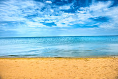 Beautiful summer sea and golden sand beach Stock Images