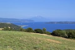Beautiful summer sea landscape with a view on Ammouliani island and Mount Athos. Halkidiki, Greece. Beautiful view on Sithonia peninsula, Ammouliani island and stock photography