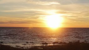 Beautiful summer sea sunset from hill. Sparkling sun beams. Boat on water. stock video footage