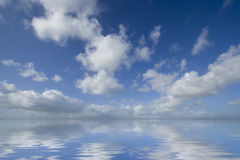Beautiful summer sky. With water reflection Stock Images
