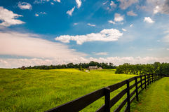 Beautiful summer sky over fence and estate in Southern York Coun Royalty Free Stock Photography